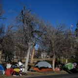 Gov. Jared Polis says he welcomes removal of homeless encampments on state property
