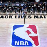 NBA players took a knee before kicking off the league's reopened season
