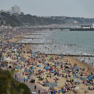 UK beaches 'unmanageable' as coastguard deals with busiest day in four years amid heatwave
