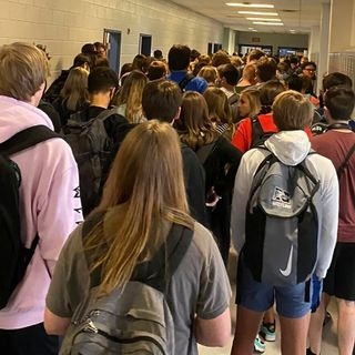 Georgia teens shared photos of maskless students in crowded hallways. Now they're suspended.