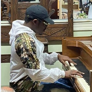 He asked to play a piano at a store. His performance went viral, and the owner gave him his first piano.