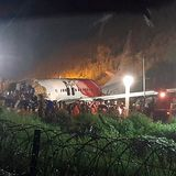 Sixteen dead and scores injured after plane crash in India