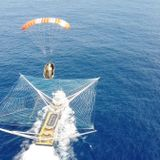 Watch SpaceX boat catch falling payload fairing in giant net (video)