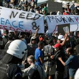 Moria migrants and Greek islanders protest over new camp