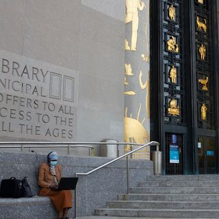 WiFi Sign of the Times as New Yorkers Gather Outside Libraries for Free Internet