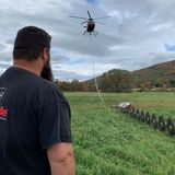 Helicopter With Hanging Saws Trims Trees Along Vt. Train Tracks