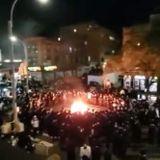 Orthodox Jews in Brooklyn burn masks during massive protest against New York's new COVID rules - U.S. News