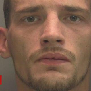 Couple sat on knife-wielding burglar