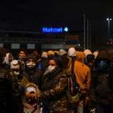 French police clear more than 2,000 people from makeshift migrant camp near Paris