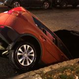 """""""We Knew This Could Happen"""": Giant Sinkhole Devours Unoccupied Taxi In Queens"""