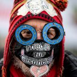 Peace protesters form human chain outside German parliament - ThinkPol