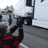 Trucks carrying Pfizer COVID vaccine met by cheering onlookers at Kalamazoo warehouse