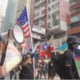 Cop-Hating Vandals or Pro-Democracy Activists?