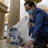 After horrifying day, lone congressman quietly picks up garbage in the Capitol Rotunda