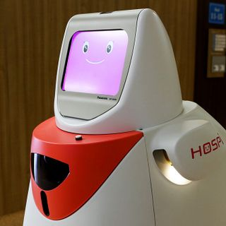 As Robots Fill the Workplace, They Must Learn to Get Along