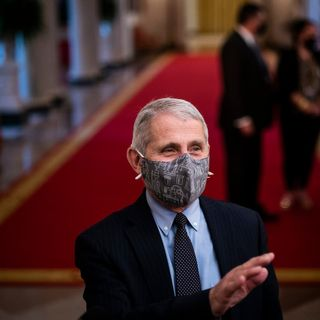When will we return to normal? The question looms as Fauci says mask-wearing may continue in 2022.