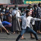Myanmar military supporters attack anti-coup protesters in Yangon