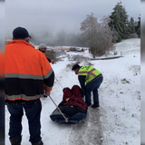 Video shows plow driver and crew using old sled to rescue COVID-19 patient trapped by snow