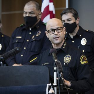Dallas police officer charged with arranging two killings