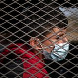 At border, record number of migrant youths wait in adult detention cells for longer than legally allowed
