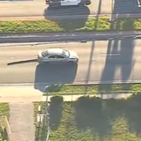 Perfect PIT Ends Police Chase of Suspected DUI Driver Dragging Spike Strip