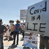 Protesters in Pacific Beach Call COVID-19 'a Lie' While Others Strike Back - Times of San Diego