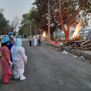 Families allowed to bury dead in their backyards as India's Covid-19 surge overwhelms crematoriums