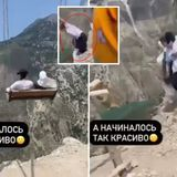 Two women fall off swing on edge of cliff when chain snaps - and SURVIVE
