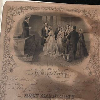 An 1870s marriage certificate was hidden behind a picture at a thrift store. Employees set out to find the couple's family.