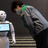 'I'm cheering for you': Robot welcome at Tokyo quarantine