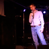 Video: Kevin Gosztola Performs At Laughing Liberally Chicago