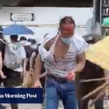 Hong Kong lawyer attacked by black-clad mob near protest area