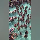 Pool party at Lake of the Ozarks in Missouri shows people crowding closely together