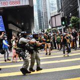 Hong Kong police fire pepper pellets at activists protesting China anthem bill