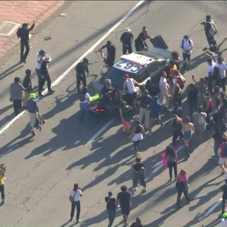 Protestors block 101 Freeway, smash patrol car window in downtown L.A. during protest over George Floyd's death