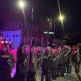 Police deploy tear gas on protestors in Greensboro, stand in riot gear on Elm Street