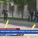 ABC4 News captures police officer armed in protest gear pushing down man with cane