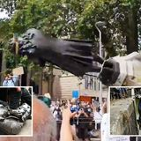 Black Lives Matter protesters topple slave trader Edward Colston statue, kneel on its neck & throw it in Bristol river