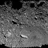 NASA spacecraft swoops down low over asteroid Bennu to eye sampling site