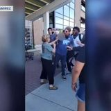 Shorewood woman seen spitting on protester in viral video wants to meet with him, apologize