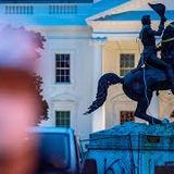 Protestors try to topple president's statue outside White House