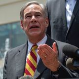 Texas governor urges people to stay home after record spike in coronavirus cases