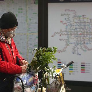 China lowers coronavirus death toll, reports 1,700 medics infected