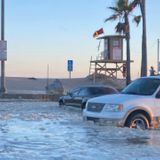 Streets flood in Newport Beach as region faces high tide, elevated surf